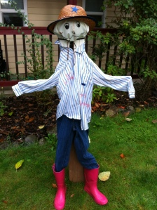 "The ""Happy Scarecrow"" C made for our front lawn last year."